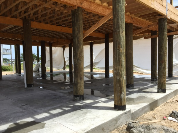 Pensacola custom home builder custom piling home on for Stilt house foundation